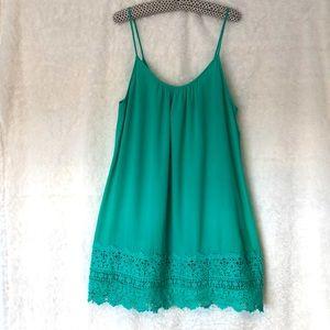Boho green mini dress with crochet detail